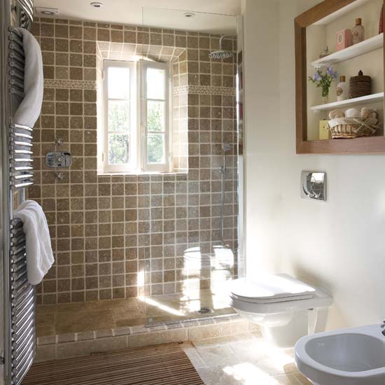This Bathroom, Completely Lined With Terracotta, Can Also Function As A Wet  Room. The White Fuse Adds An Accent To The Brown Glazed Bathroom Tiles.